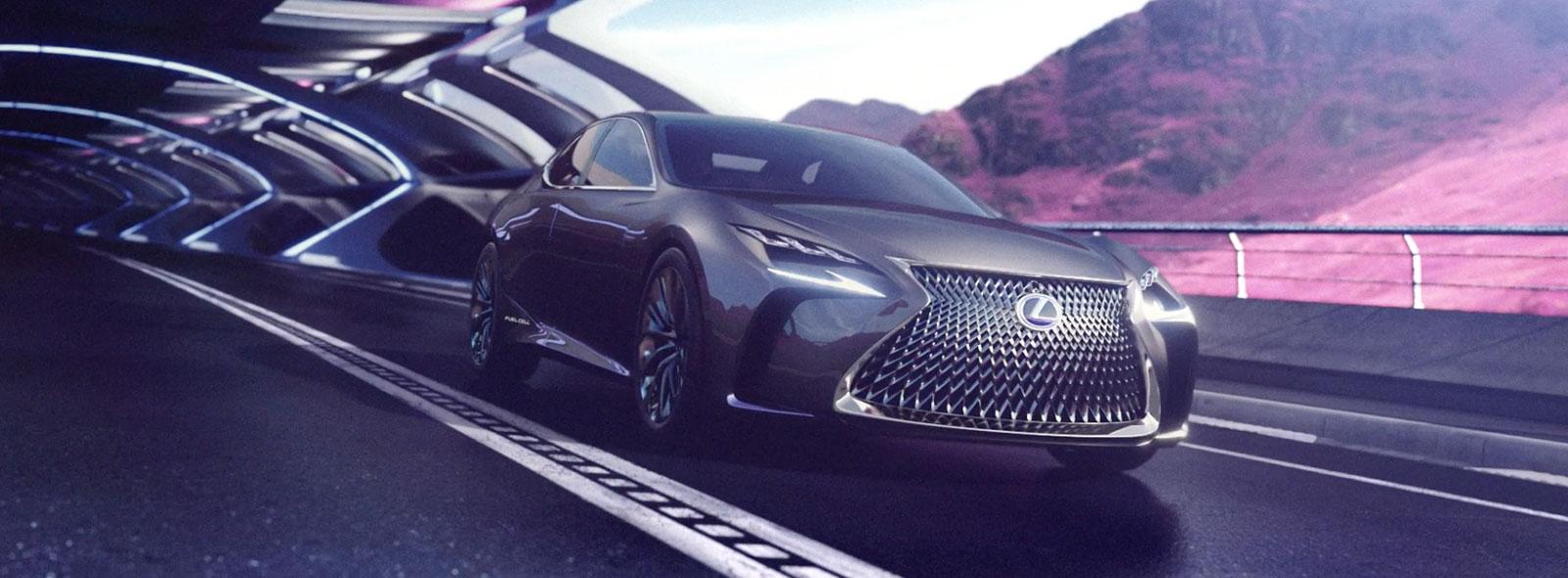 Vista anteriore della concept car LF CC mentre percorre una galleria futuristica