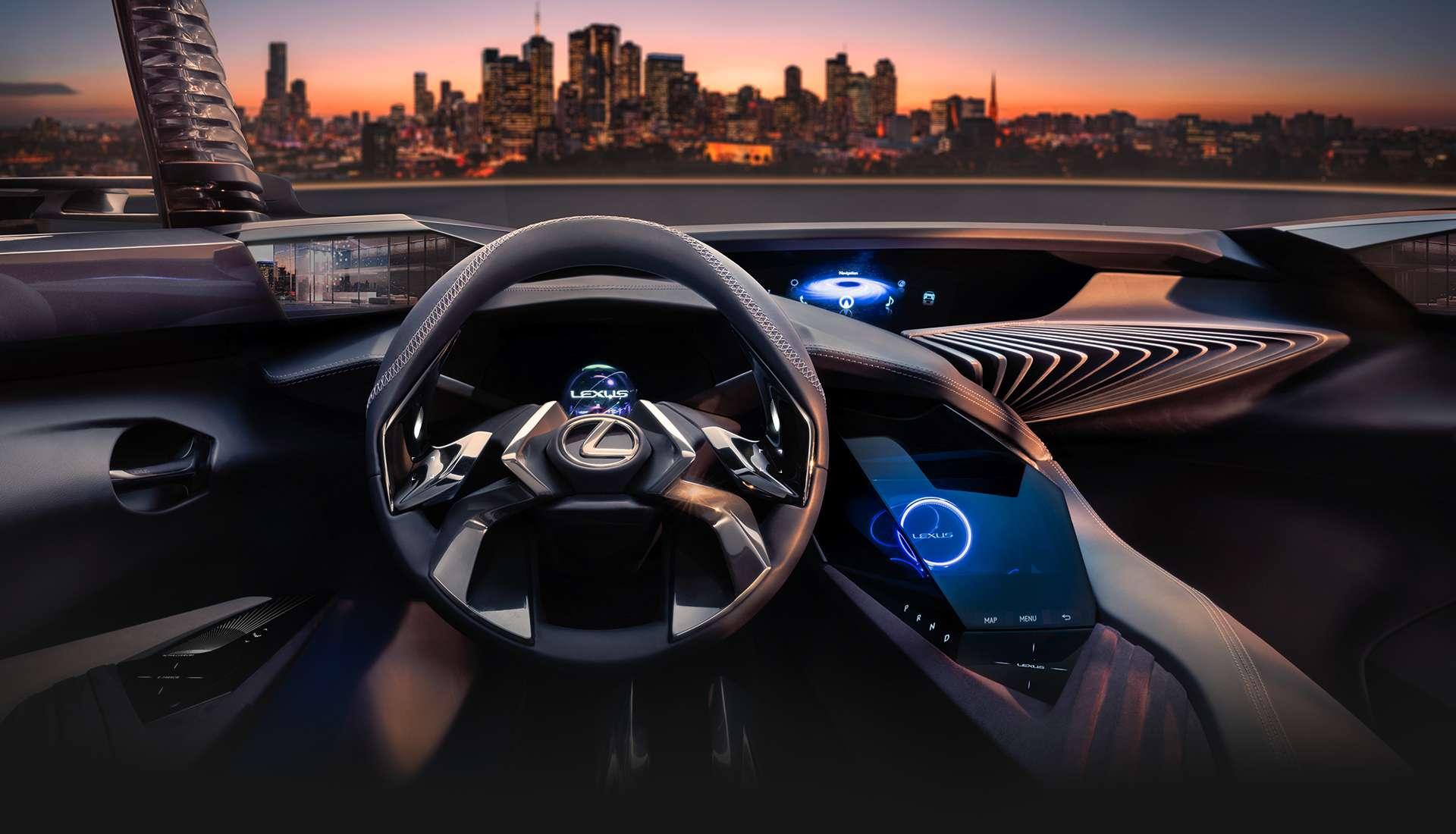 Interni di una Lexus UX concept car con il volante futuristico in primo piano