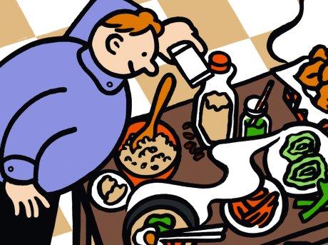 Fumetto di un uomo seduto ad una tavola imbandita mentre condisce alcune pietanze